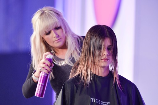 Molbys Hair stylist preparing a model at Tigi Awards 2014